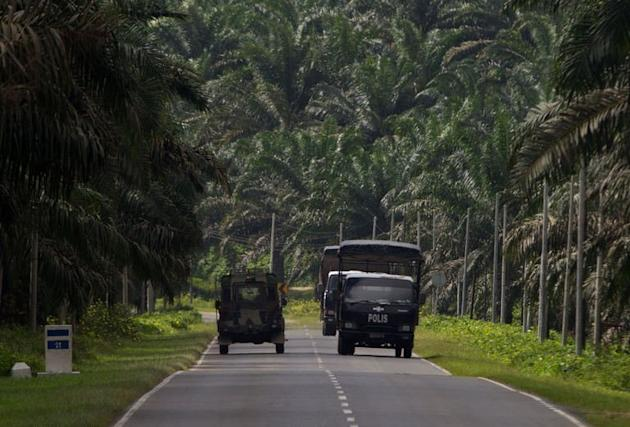 Malaysian police and military trucks are shown in Lahad Datu on Borneo island, on March 3, 2013. Malaysia vowed to beef up security in an area where at least 26 people have been reported killed after a bizarre invasion by Philippine followers of a self-styled sultan