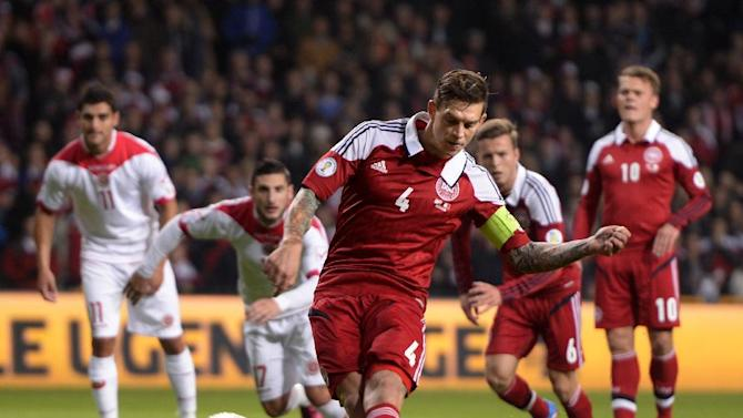 Denmark's Daniel Agger, centre, scores a goal from the penalty spot during their  Group B 2014 FIFA World Cup qualifying soccer match against Malta, played in Parken, Copenhagen on Tuesday, Oct 15, 2013
