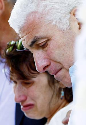 "Amy Winehouse's parents Mitch and Janis weep as they view floral tributes outside their daughter's home in London's Camden Square, Monday July 25, 2011. Mitch Winehouse greeted and thanked mourners for coming to lay bouquets, messages and handwritten notes, only hours before police promised to release a post mortem on her death. ""This means so much to my family,"" he said. The 27-year-old singer died Saturday after publicly struggling with drug and alcohol abuse for years.(AP Photo/Sean Dempsey-pa)  UNITED KINGDOM OUT: NO SALES: NO ARCHIVE:"