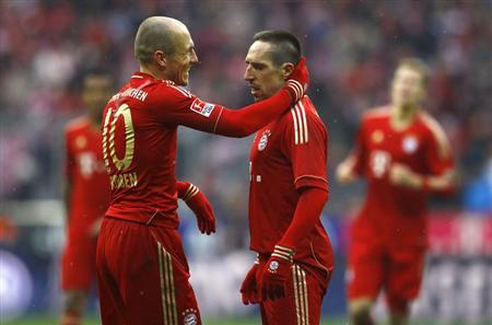 Franck Ribery of Bayern Munich celebrates his second goal against FC Schalke 04 with team mate Arjen Robben (L) during their German first division Bundesliga soccer match in Munich, February 26, 2012. REUTERS/Kai Pfaffenbach/Files