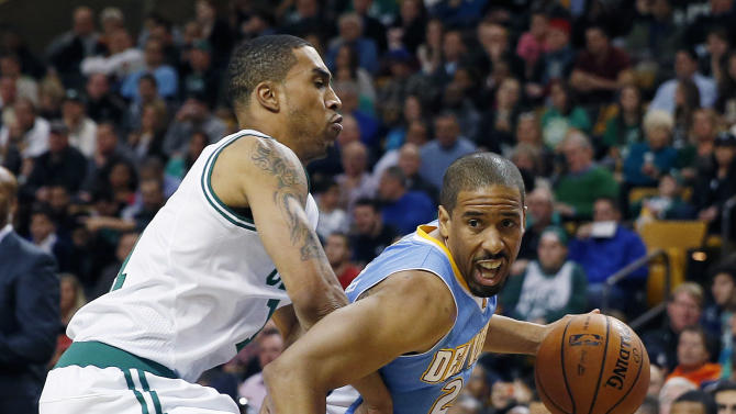 Denver Nuggets' Andre Miller (24) drives past Boston Celtics' Courtney Lee (11) in the second quarter of an NBA basketball game in Boston, Friday, Dec. 6, 2013