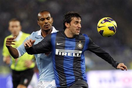 Inter Milan's Milito and SS Lazio's Konko fight for the ball during their Italian Serie A soccer match in Rome