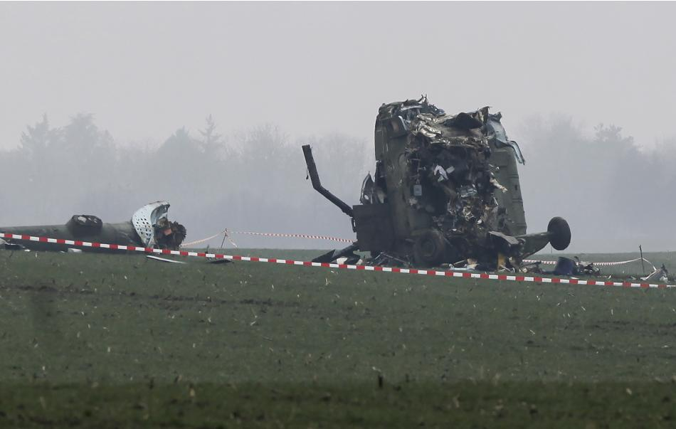 The wreckage of a military helicopter is pictured at the crash site near Belgrade airport