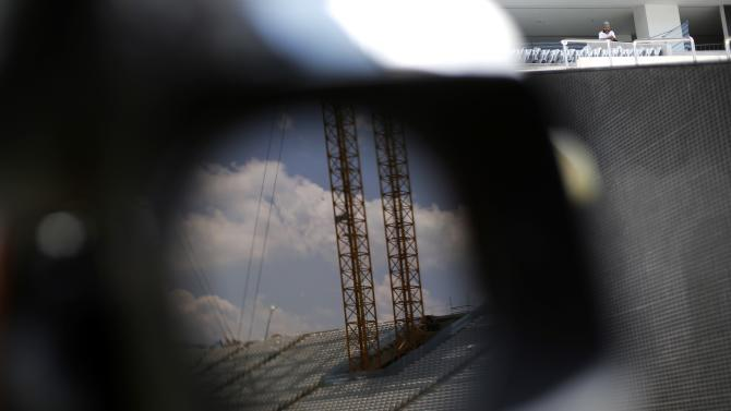The Arena Corinthians stadium, which is being prepared to host 2014 World Cup matches, is reflected in a camera lens in Sao Paulo
