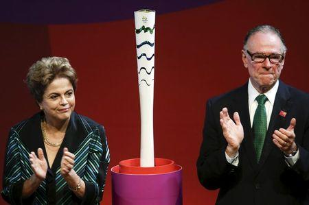 Brazil's President Rousseff and Rio 2016 Olympic Games Organising Committee President Nuzman applaud next to Olympic torch model in Brasilia