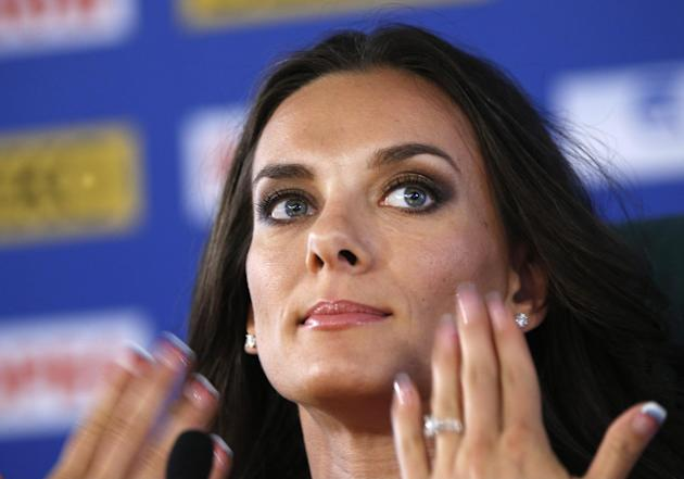 Russia's Yelena Isinbayeva, the gold medalist in the women's pole vault, gestures during a press conference at the World Athletics Championships in the Luzhniki stadium in Moscow, Russia, Thursday, Au