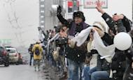 Hundreds of Russians have begun linking hands around the Moscow inner ring road in symbolic protest against Prime Minister Vladimir Putin's expected return to a third term as president in March 4 polls