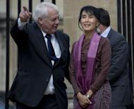 Myanmar democracy icon Aung San Suu Kyi (R) is greeted by the Chancellor of the Universty of Oxford Chris Patten during a visit to Oxford University. The Myanmar democracy icon spent nearly 20 years in Oxford and brought up her family there, and when she left for her homeland to care for her dying mother in 1988 she had no idea it would be nearly a quarter of a century before she would return