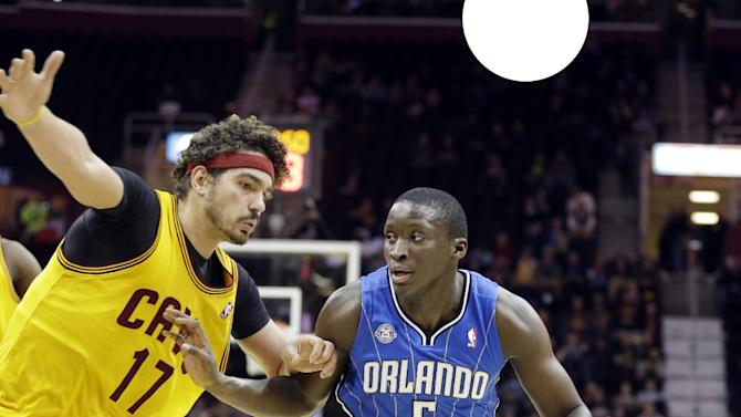 Orlando Magic's Victor Oladipo (5) drives past Cleveland Cavaliers' Anderson Varejao (17), from Brazil, during the fourth quarter of an NBA basketball game Thursday, Jan. 2, 2014, in Cleveland. The Cavaliers won 87-81