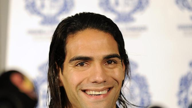 Colombian soccer star Radamel Falcao reacts as he attends a news conference at the Trindade Hospital in Porto, Portugal, Monday, Jan. 27, 2014. Colombia and Monaco's striker Falcao is in a race against time to get fit for the World Cup in June after undergoing knee surgery Saturday, Jan. 25, with his doctor giving him a better than 50-50 chance of making it