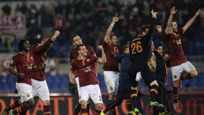 AS Roma's players celebrate at the end of their Italian Serie A soccer match against Torino at the Olympic stadium in Rome