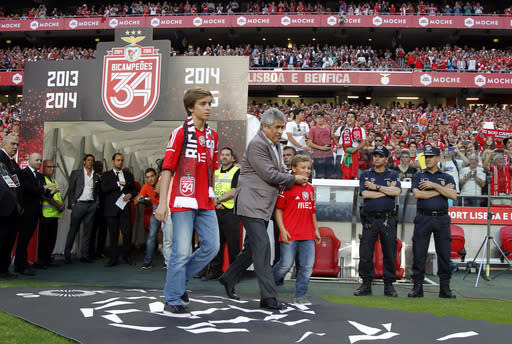Benfica celebrates title with sons of fan beaten by police