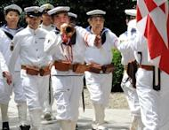 War veterans and others wearing uniforms of the Imperial Navy march at the Yasukuni shrine to honour the dead on the 67th anniversary of Japan's surrender from World War II in Tokyo. China and South Korea have pressed Japan to face up to its wartime past, as festering territorial disputes flared and Asia marked the anniversary of Tokyo's World War II surrender