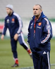 France rugby coach Philippe Saint Andre watches his side training, on February 8, 2013, at the Stade de France in Paris. Saint-Andre is looking for a much improved performance from his men in the clash with Wales