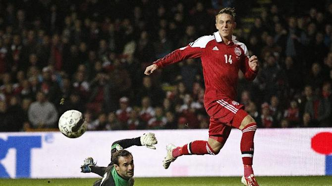 Denmark's Nicki Bille Nielsen, right, scores a goal past Malta's Justin Haber to bring the score to 6-0, during their Group B 2014  World Cup qualifying soccer match played in Parken, Copenhagen on Tuesday, Oct 15, 2013. (AP Photo / POLFOTO, Jens Dresling)