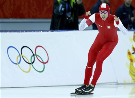 Zbigniew Brodka of Poland reacts after competing in the men's 1,500 metres speed skating race during the 2014 Sochi Winter Olympics, February 15, 2014. REUTERS/Issei Kato