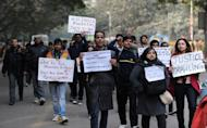 Poeple protest against a gang rape, in New Delhi, on January 6, 2013. Claims of police incompetence and public apathy stirred new anger in the Delhi gang-rape case after the boyfriend of the victim recounted details of the savage attack for the first time