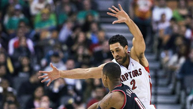 Toronto Raptors Landry Fields defends against the Portland Trail Blazers Damian Lillard during an NBA basketball game in Toronto on Sunday, Nov. 17, 2013