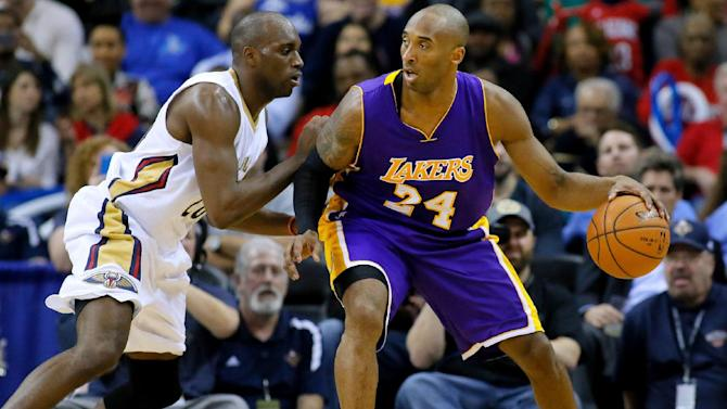 FILE - In this Wednesday, Jan. 21, 2015, file photo, Los Angeles Lakers guard Kobe Bryant (24) drives against New Orleans Pelicans guard Quincy Pondexter (20) during the second half of an NBA basketball game in New Orleans. Bryant came the closest to Wilt Chamberlain 100 in January 2006 with 81 points. The Los Angeles Lakers star scored 55 points after halftime, racking up 27 points on 11-for-15 shooting in the third quarter and 28 more in the fourth. (AP Photo/Jonathan Bachman, File)
