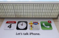 An advertisement about iPhone is shown before an announcement at Apple headquarters in Cupertino, Calif., Tuesday, Oct. 4, 2011. (AP Photo/Paul Sakuma)