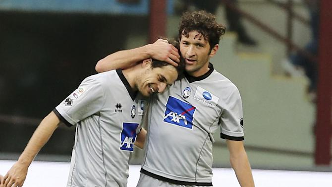 Atalanta midfielder Giacomo Bonaventura, left, celebrates with his teammate Marko Livaja, of Croatia, after winning the Serie A soccer match between Inter Milan and Atalanta at the San Siro stadium in Milan, Italy, Sunday, March 23, 2014. Inter Milan won 2-1