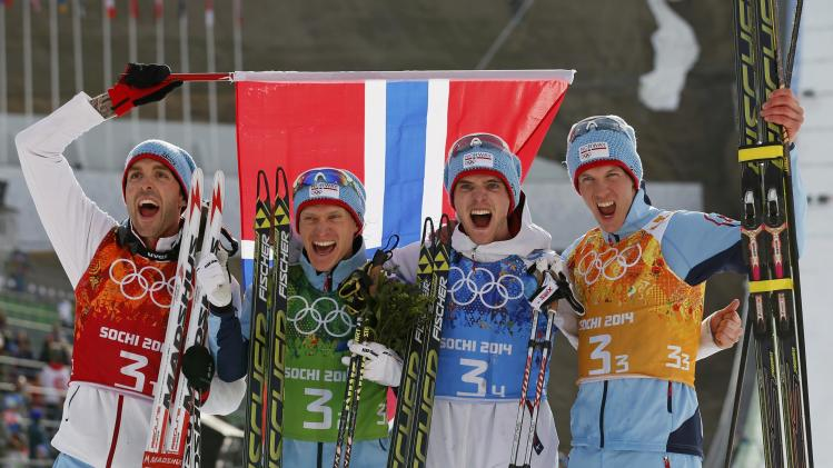 Norway's winning team members Moan, Klemetsen, Graabak and Krog celebrate after the flower ceremony for the of the Nordic Combined team Gundersen event of the Sochi 2014 Winter Olympic Games