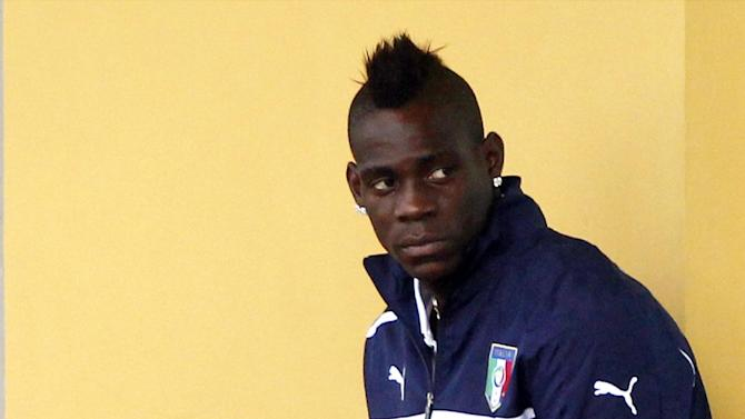 Italy's Mario Balotelli waits for the start of a training session at the Coverciano training grounds, near Florence, Italy, Monday, Oct. 7, 2013. Italy is scheduled to play a Would Cup qualifier soccer match against Denmark, in Copenhagen Friday Oct. 11