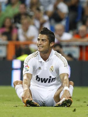 Real Madrid's Cristiano Ronaldo from Portugal reacts during the Santiago Bernabeu Trophy  soccer match against Galatasaray at the Santiago Bernabeu stadium in Madrid, Spain, Wednesday, Aug. 24, 2011. (AP Photo/Andres Kudacki)