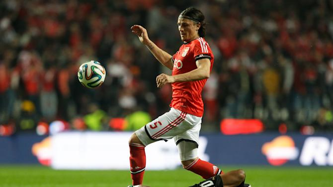 Benfica's Fejsa downs Sporting's Heldon, left, during their Portuguese league soccer match Tuesday, Feb. 11 2014, at Benfica's Luz stadium in Lisbon
