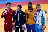 L-R: Silver medallist Canada's Tonya Lynn Verbeek, gold medallist Japan's Saori Yoshida and bronze medallists Colombia's Jackeline Renteria Castillo and Azerbaijan's Yuliya Ratkevich pose on the podium after the women's 55kg freestyle medal finals during the wrestling event of the London 2012 Olympic Games