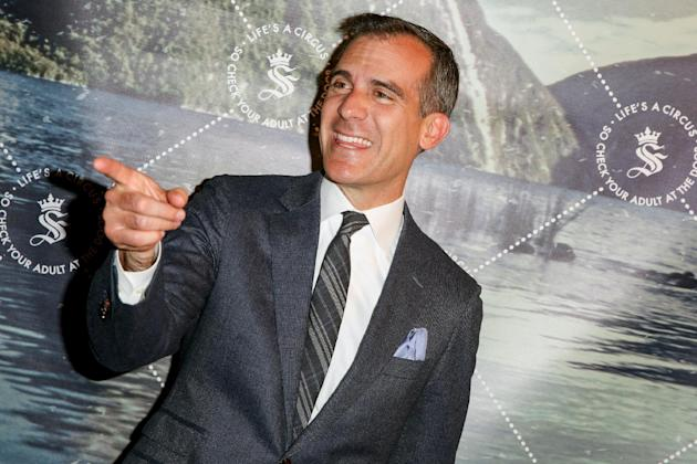 Los Angeles Mayor Eric Garcetti arrives at The Unveiling of Seedling's Arts District Headquarters on Thursday, May 28, 2015, in Los Angeles. (Photo by Rich Fury/Invision/AP)