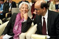 International Monetary Fund (IMF) Managing Director Christine Lagarde and Singapore Finance Minister and International Monetary and Financial Committee (IMFC) chair Tharman Shanmugaratnam chat before the start of the International Monetary and Financial Committee (IMFC) plenary session at the IMF/World Bank Annual Spring Meetings in Washington