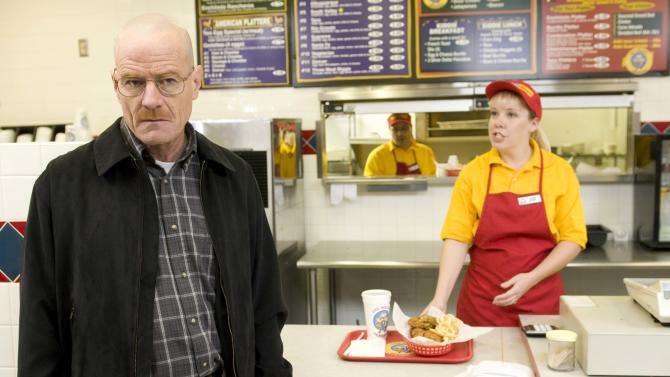 """This image released by AMC shows Bryan Cranston as Walter White at the fictional restaurant """"Los Pollos Hermanos"""" in a scene from season 2 of the AMC series """"Breaking Bad.""""  A Twisters burrito restaurant in Albuquerque that serves as the location for the restaurant has become an international tourist attraction as people come from all over the world to see the spot where a fictional drug trafficker runs his organization. (AP Photo/AMC)"""