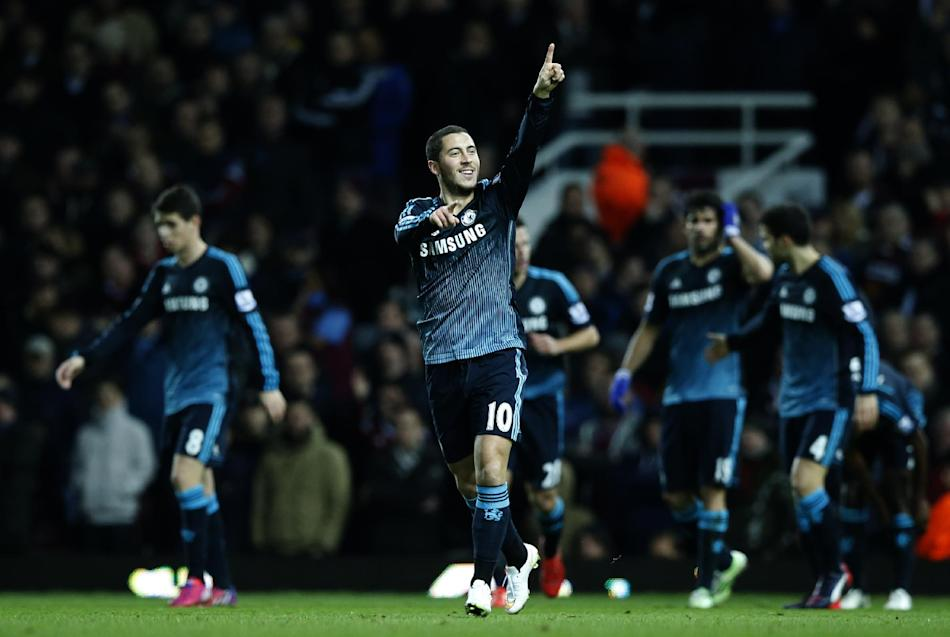 Chelsea's Eden Hazard celebrates after scoring the opening goal of the game during the English Premier League soccer match between West Ham United and Chelsea , at the Boleyn ground in London, Wed