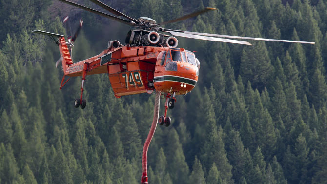 A type 1 sky crane fills up on fire retardant at a Heliwell mobile retardant base while battling the Beaver Creek Fire. Monday Aug. 19, 2013. (AP Photo/Idaho Statesman, Kyle Green)