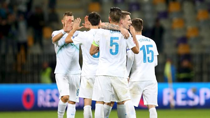 Slovenia's players celebrate their win after Euro 2016 qualifying soccer match against Estonia in Maribor