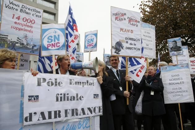Striking employees of Air France demonstrate in front of the Air France headquarters building at the Charles de Gaulle International Airport in Roissy
