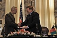 Afghanistan's Defence Minister Abdul Rahim Wardak (R) shakes hands with US commander in Afghanistan, General John Allen (L) during a ceremony at the foreign ministry in Kabul. The leaders signed a deal transferring control of the Bagram prison to the Afghan government, marking a breakthrough in negotiations on a strategic treaty between the two nations