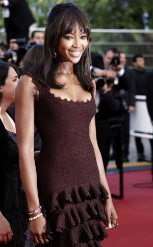 "FILE - In this May 17, 2011 file photo, model Naomi Campbell poses on the red carpet for the screening of ""The Beaver"" at the 64th international film festival, in Cannes, southern France. Campbell will be honored at the annual The Angel Ball, which supports cancer research on Oct. 17, in New York. (AP Photo/Lionel Cironneau, file)"