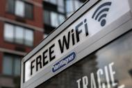 """A free Wi-Fi hotspot beams broadband internet from atop a public phone booth in July 2012 in Manhattan, New York City. So-called """"Super Wi-Fi,"""" which offers a bigger range than existing hotspots, is being deployed in the United States and generating interest in a number of countries, including Britain and Brazil"""
