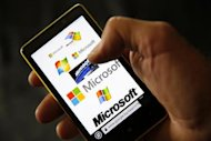 A Nokia Lumia 820 smartphone with Microsoft logos on the screen is shown in a photo illustration taken in the central Bosnian town of Zenica, September 3, 2013. REUTERS/Dado Ruvic