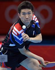 South Korea's Ryu Seungmin returns a shot to North Korea's Kim Hyok Bong during the table tennis match at the Excel centre in London. North and South Korea are technically still at war after the 1950-53 conflict and any sporting occasion, pitting the one against the other, always attracts attention, cranking up the pressure on the athletes involved