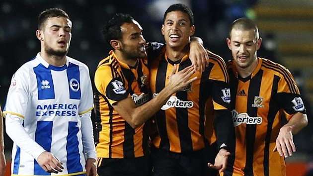 Hull City's Curtis Davies (2nd R) celebrates his goal against Brighton Hove Albion with Ahmed Elmonhamady (2nd L) and Matty Fryatt (R) (Reuters)