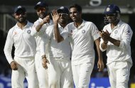 India's Bhuvneshwar Kumar second right, celebrates with teammates the wicket of England's Gary Ballance, during the second day of the second test match between England and India at Lord's cricket ground in London, Friday, July 18, 2014. (AP Photo/Kirsty Wigglesworth)