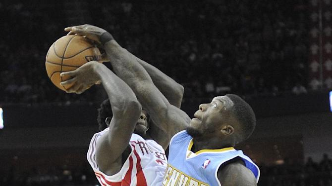 Denver Nuggets' Nate Robinson (10) puts a stop to an attempted pass by Houston Rockets' Patrick Beverley in the second half of an NBA basketball game Saturday, Nov. 16, 2013, in Houston. The Rockets won 122-111