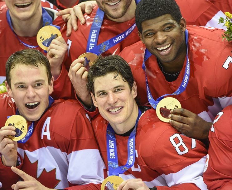 Sidney Crosby and Team Canada celebrate their gold medal win after the Sochi 2014 Winter Olympic Games: Men's hockey, Gold medal game against Sweden. 3rd period action. (Photo by Christopher Morris/Corbis via Getty Images)
