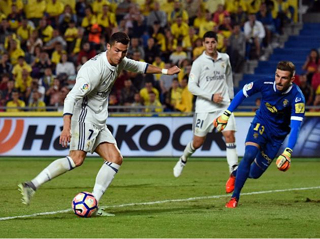 Real Madrid's forward Cristiano Ronaldo (L)  was replaced 18 minutes from time against Las Palmas