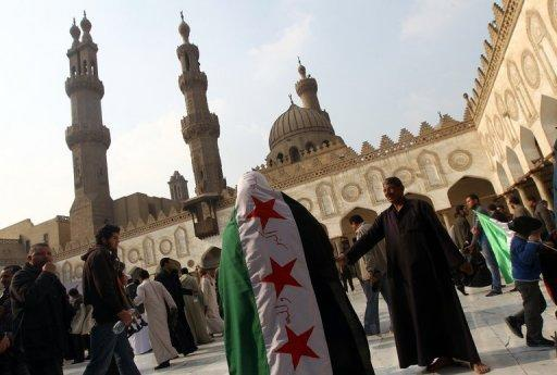 A rally in support of the Syrian people and against Syria's President Bashar al-Assad in Al-Azhar mosque in Cairo. Russia said Saturday there was still a chance of finding a political solution to the Syrian conflict but warned that President Bashar al-Assad would not be persuaded to leave power.