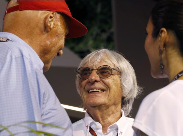 Formula One Chief Executive Ecclestone talks with former Formula One racing driver Lauda after the qualifying session of the Singapore F1 Grand Prix in Singapore