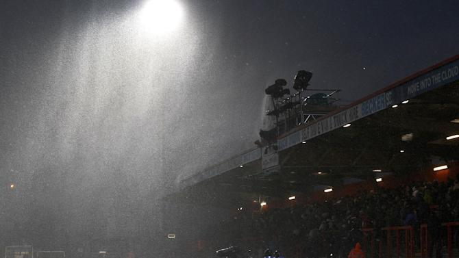 Heavy rain pours down on the stadium before the start of the English FA Cup fourth round soccer match between Stevenage and Everton at the Lamex Stadium, Stevenage, England, Saturday, Jan. 25, 2014